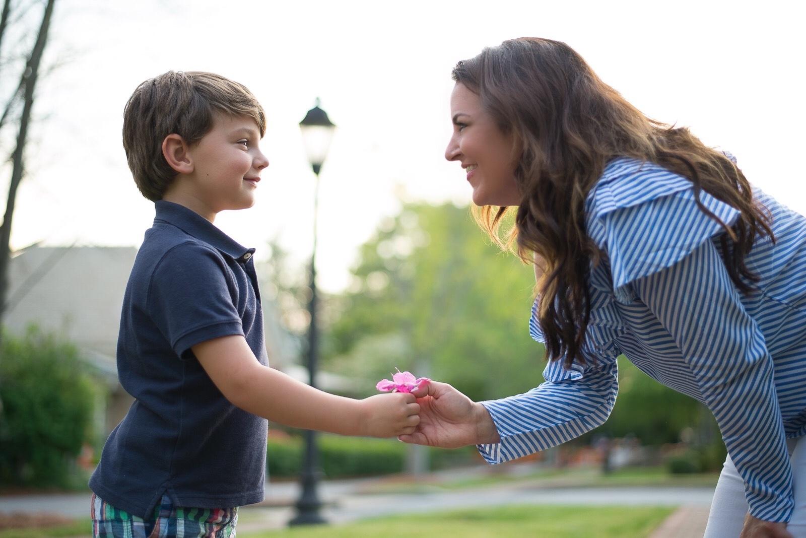 Knox giving his mom Kim a flower
