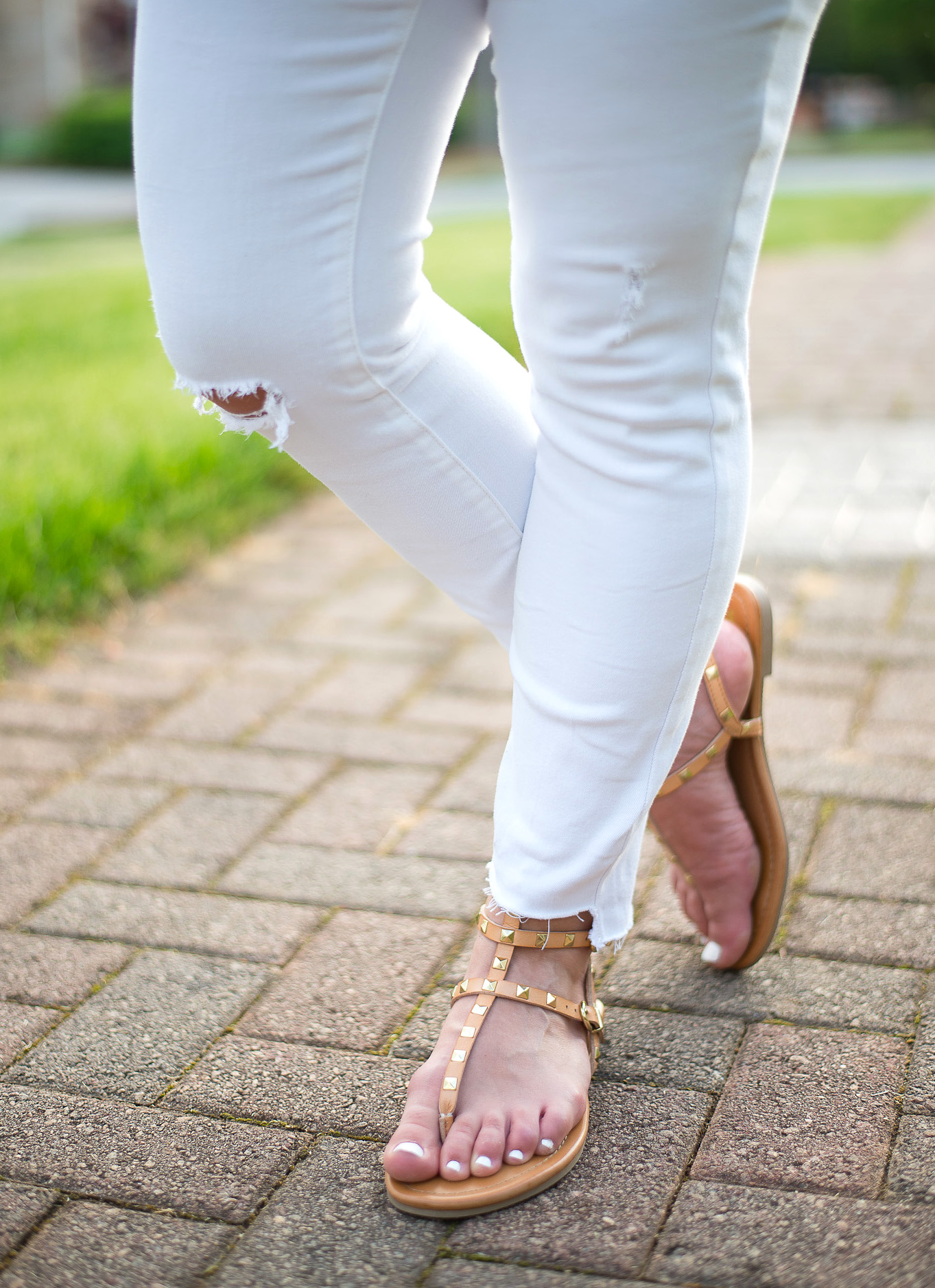 Rockstud gertie gladiator sandals in tan with frayed hem jeans
