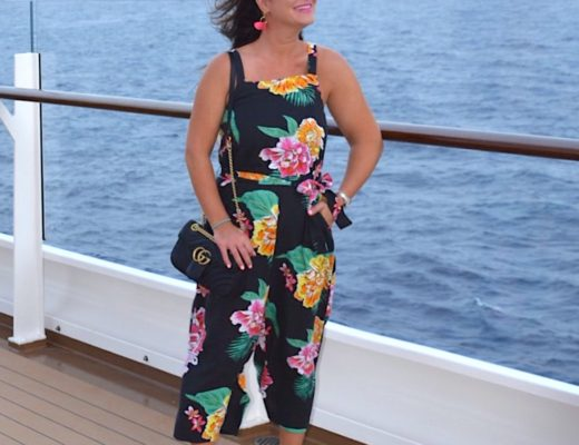 Linen-Blend Floral Jumpsuit with mirrored sunglasses and Gucci Marmont Bag